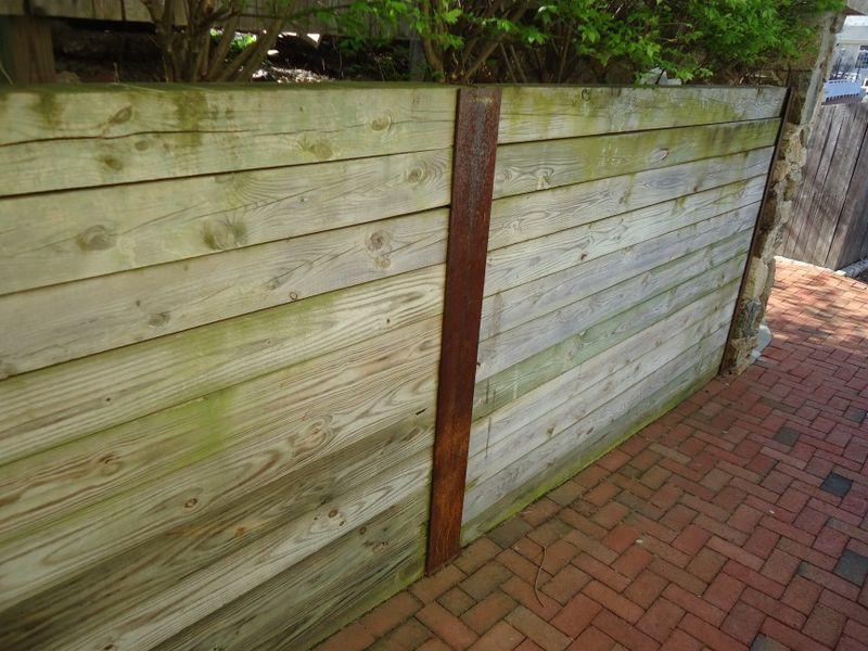 Retaining_wall_built_with_vertical_I-beams_and_pressure_treated_lumber